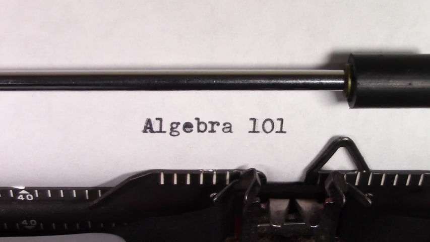 """A close up video of the words """"Algebra 101 """" being typed on white paper in an old manual typewriter. Shot in macro.   Shutterstock HD Video #1031830460"""