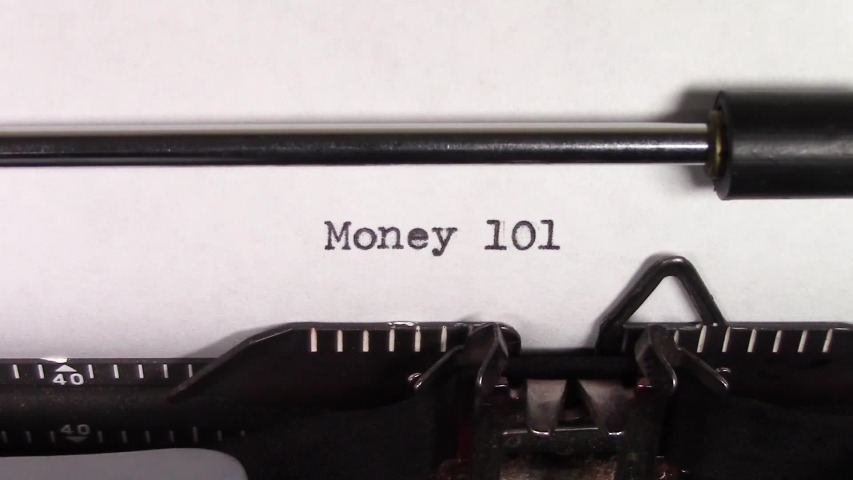 """A close up video of the words """"Money 101 """" being typed on white paper in an old manual typewriter. Shot in macro.   Shutterstock HD Video #1031830490"""