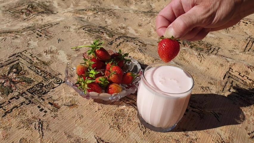 Strawberry yogurt and fresh strawberries. | Shutterstock HD Video #1031868830