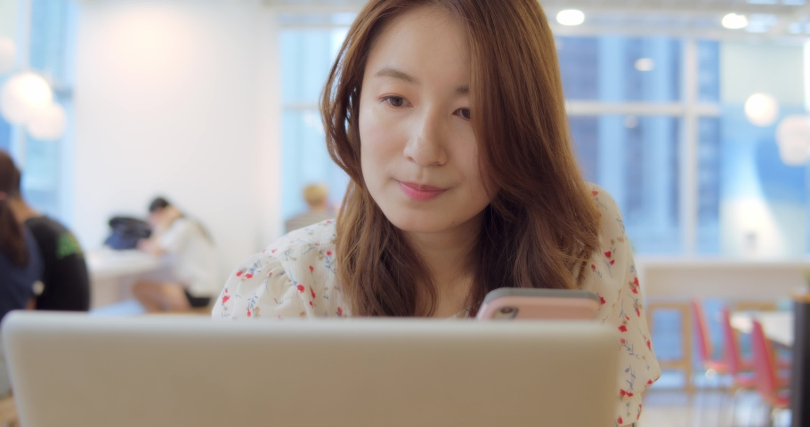 Business Woman Working With Computer And Smart Phone At Office | Shutterstock HD Video #1032078860