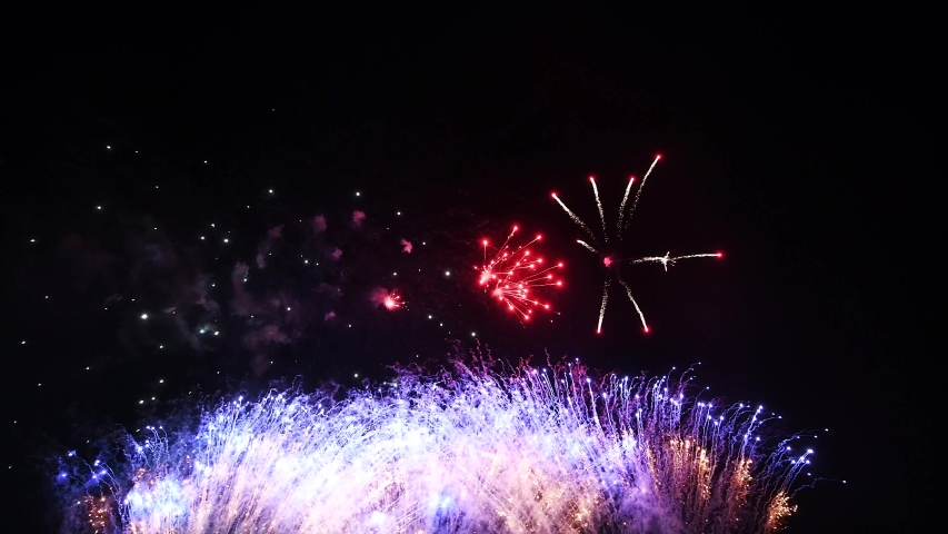 Real Fireworks footage 4k video on Deep Black Background Sky on Futuristic Fireworks festival show before independence day on 4 of July | Shutterstock HD Video #1032304790