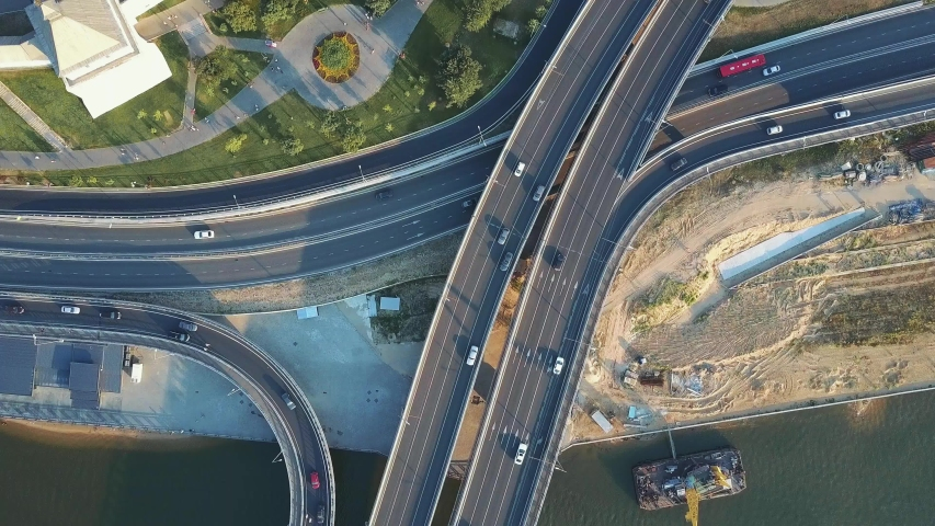 Aerial view of the main road in the city. Top view of the road junction by the river. 4K aerial view | Shutterstock HD Video #1032305330