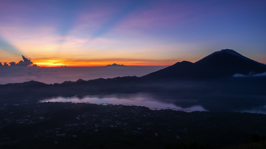 Bali, Indonesia, time lapse view of sunrise from Mount Batur.    Shutterstock HD Video #1032381650