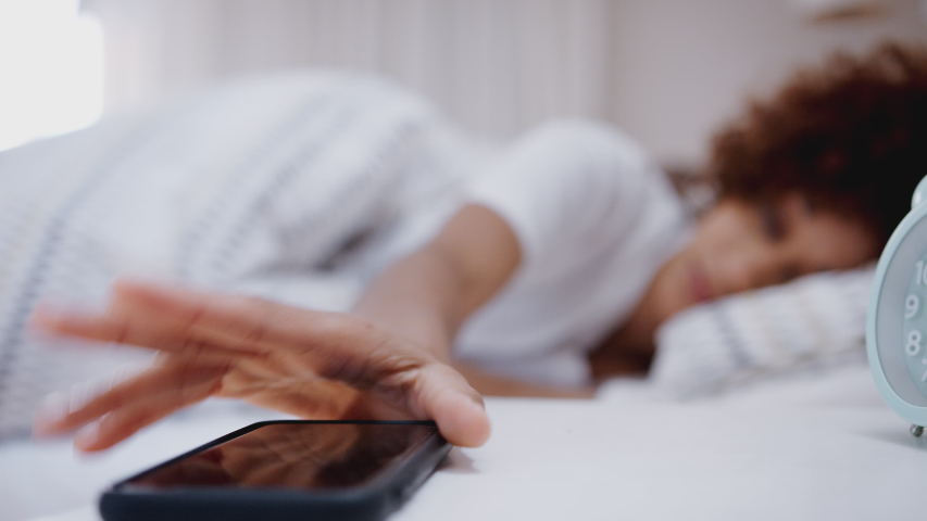 Woman Asleep In Bed Reaches Out To Turn Off Alarm On Mobile Phone | Shutterstock HD Video #1032393740