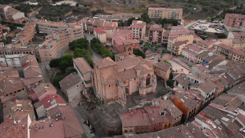 Aerial view of Estella, Spanish town along Camino de Santiago or Way of St. James. Urban landscape with buildings and old church in Navarra region, Spain seen from drone flying in sky | Shutterstock HD Video #1032445520