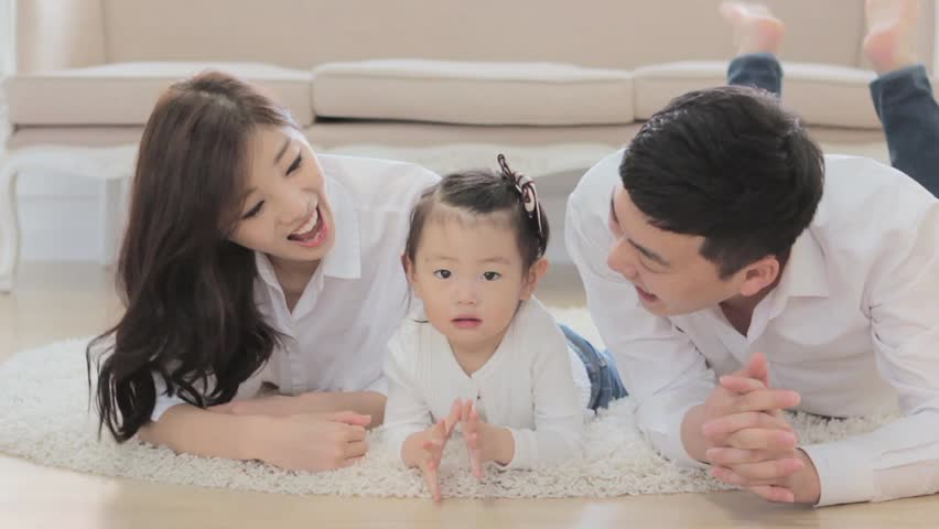 happy Asian family looking at a camera with a happy smile