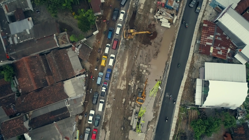 Traffic jam top view aerial footage at ring road Yogyakarta city, Indonesia. Shows of construction progress on site | Shutterstock HD Video #1032503660