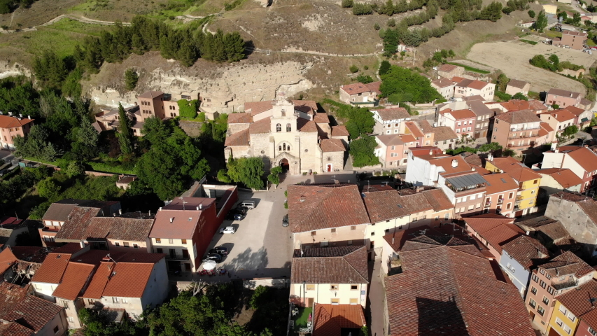 Aerial view of Belorado, Spanish village in the province of Burgos, Castile-Leon, Spain along Camino de Santiago or Way of St James. Landscape with Church of Santa Maria seen from drone flying in sky | Shutterstock HD Video #1032518360