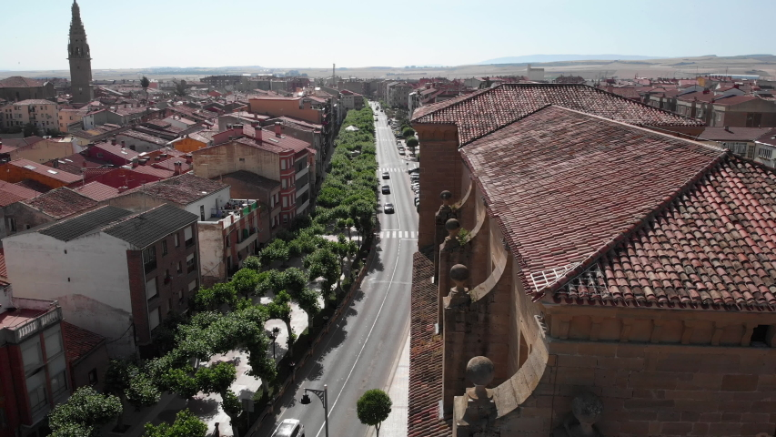 Aerial view of Santo Domingo de la Calzada, small Spanish village in Spain along Camino de Santiago or Way of St James. Urban landscape with buildings seen from drone flying in sky | Shutterstock HD Video #1032518390