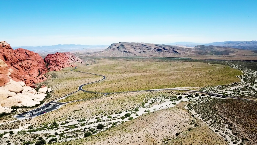 Left pan drone flyover of Calico Hills at Red Rock Canyon National Conservation area Las Vegas Nevada.   Shutterstock HD Video #1032752810