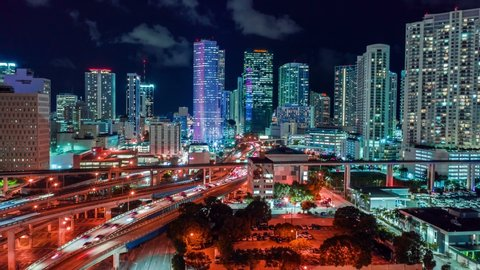 Miami downtown timelapse hyperlapse. Beautiful aerial shot of Miami city. Drone flying over a city night lights Miami in 4K