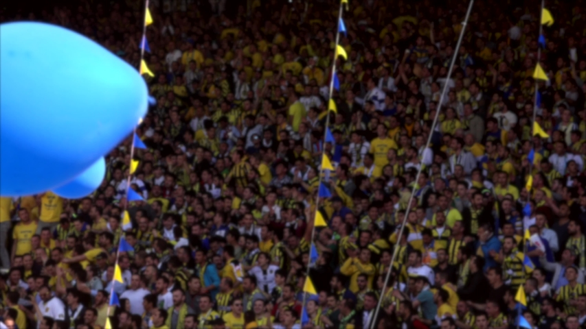 Excited and happy fans hugging, dancing in joy at stadium. Crowded cheering. Cheer in the tribune. Football team spectators. Group music, sing singing applause clap net. Soccer match supporter. | Shutterstock HD Video #1032886730
