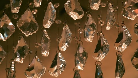 Racking focus of beautiful crystals of a luxury chandelier. Shining crystal background.