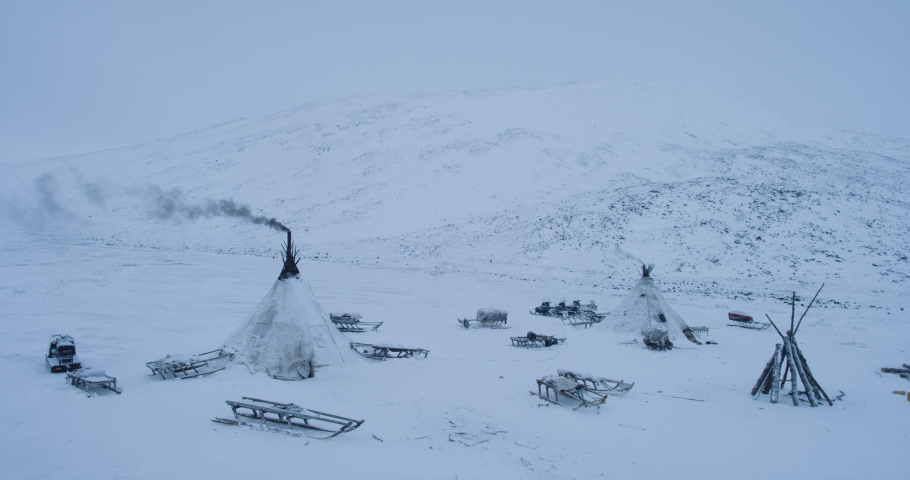 Capturing from the top with drone a camp of yurts in Yamal many sleigh outside the yurts amazing view. | Shutterstock HD Video #1032994490