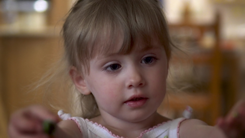 Little girl looks at the camera close-up | Shutterstock HD Video #1033007540