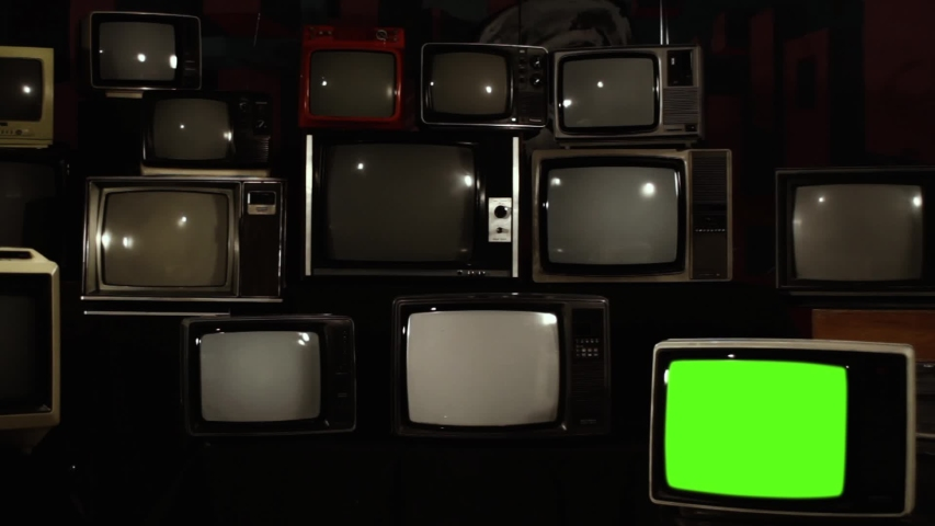 """Pile of Retro TVs from 80s and One TV Turning Off Green Screen.  Zoom Out. You can replace green screen with the footage or picture you want with """"Keying"""" effect in After Effects. 