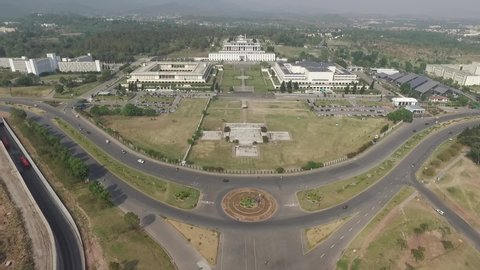 Islamabad, Pakistan - March, 2019: Drone View of D Chowk Islamabad, Zoom In to President House, Parliament and Senate of Pakistan, Aerial View Day Light Shot of Green Capital City of Pakistan