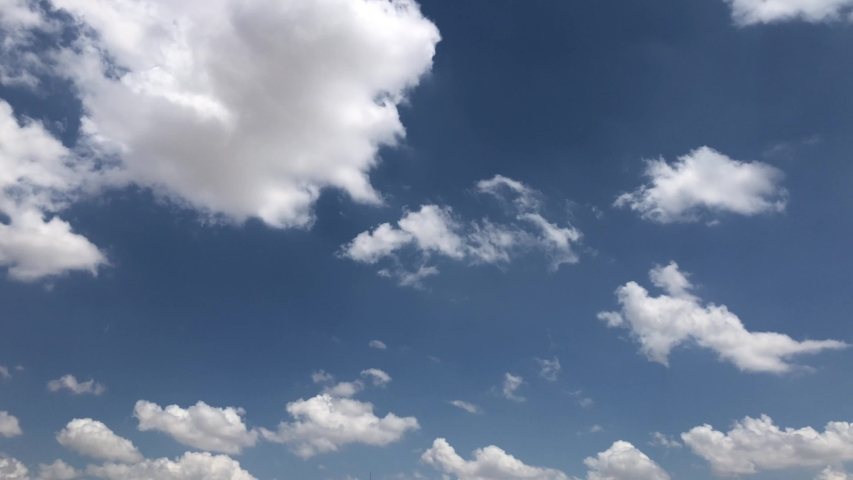 CLEAR 4K high beautiful cloud space weather beautiful blue sky glow clouds background Sky 4K clouds weather nature cloud blue Blue sky with clouds 4K sun Time lapse clouds 4k rolling puffy cloud movie | Shutterstock HD Video #1033444580
