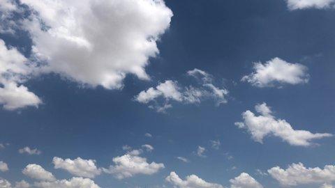 CLEAR 4K high beautiful cloud space weather beautiful blue sky glow clouds background Sky 4K clouds weather nature cloud blue Blue sky with clouds 4K sun Time lapse clouds 4k rolling puffy cloud movie