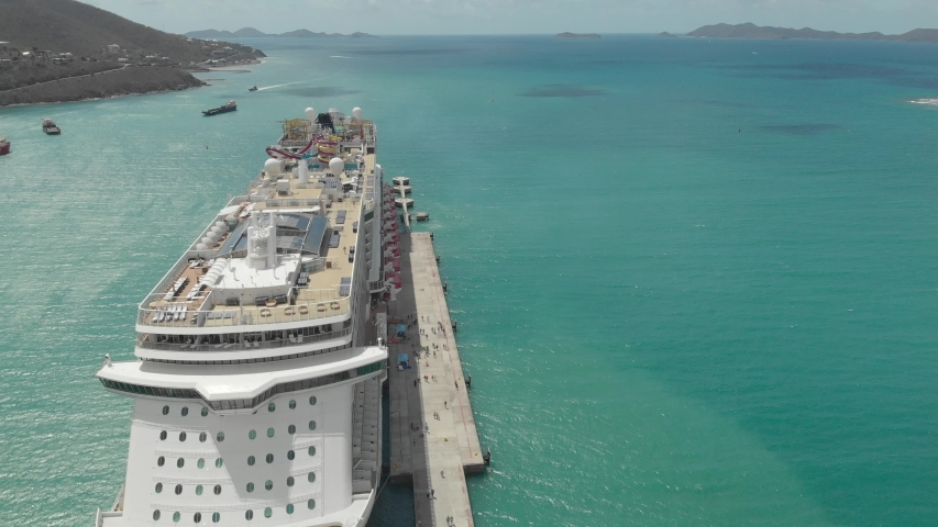 Cruise ship in the blue lagoon. Stay on the pier, Bahamas. Journey on a huge cruise ship, top view | Shutterstock HD Video #1033552760