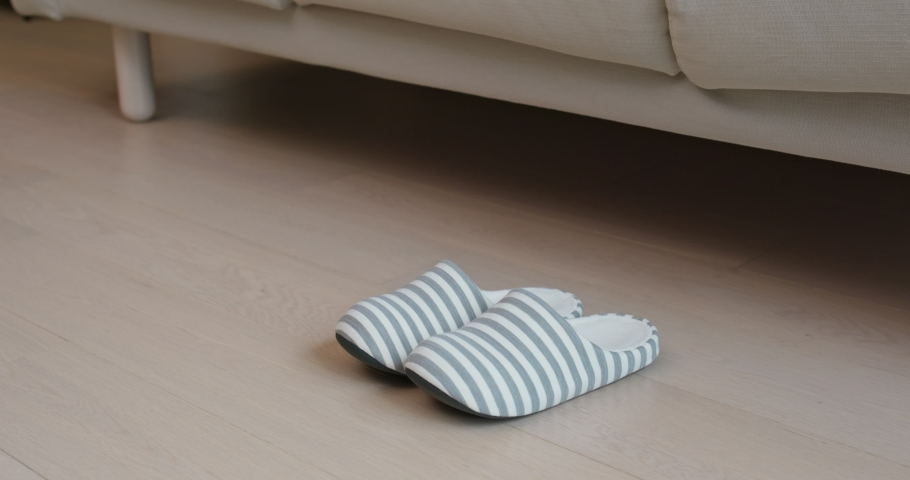 Woman wearing slipper at home | Shutterstock HD Video #1033700060