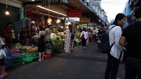 Bangkok, Thailand - June 25, 2019: A busy late evening at Huai Khwang market which is a vegetable market in Bangkok. In Bangkok there are many place where you can buy local food at a cheaper rate.