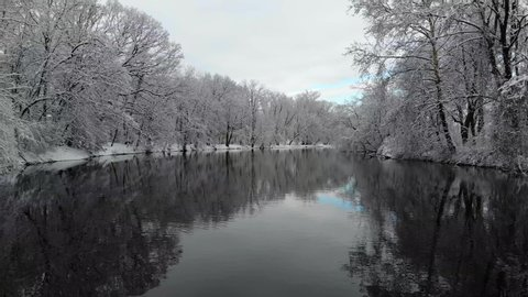 4k Snow Covered Trees River Lake Winter Blue Sky Woods Wonderland Drone Over Water Ice