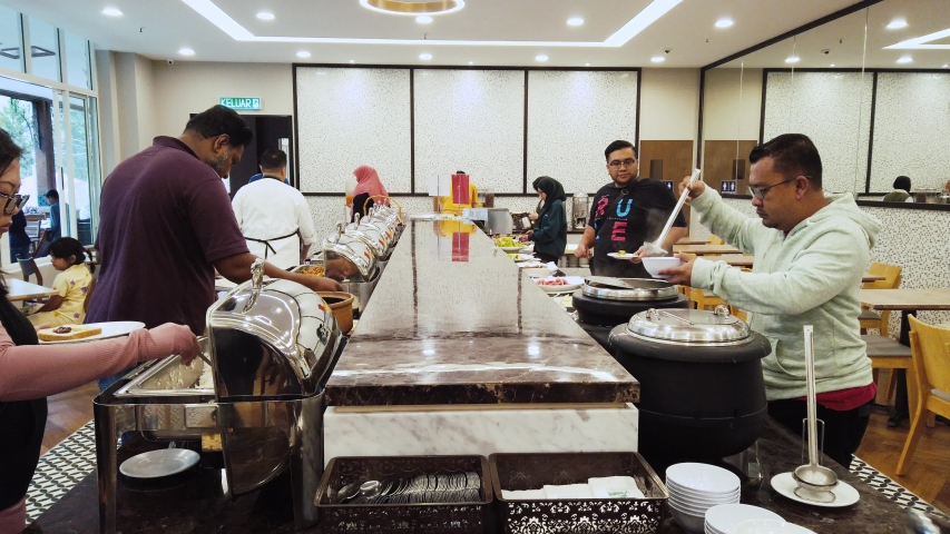 CAMERON HIGHLAND,PAHANG-CIRCA JULY,2019 : people grab a various type of dessert at hotel for breakfast buffet. #1033820060