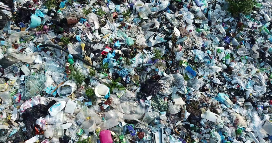 Plastic in the mountains, Mountain garbage, large garbage pile, degraded garbage. Pile of stink and toxic residue. These garbage come from urban areas, industrial areas. Consumer society Cause massive | Shutterstock HD Video #1033987070