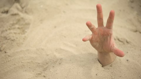 Hand sinking in quicksand, grasping stick to get out, tips to survive in desert