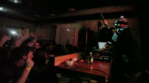 Moscow-11 december,2015:american hip hop music producer eric stephens known  by his stage name apollo brown playing musical tracks in night club with  digital midi turntable controller device