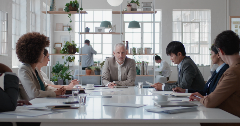 Mature businessman executive meeting corporate leaders discussing development ideas with shareholders brainstorming in office boardroom   Shutterstock HD Video #1034536190