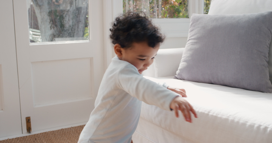 Happy baby learning to walk smiling toddler having fun taking first steps walking enjoying childhood curiosity 4k | Shutterstock HD Video #1034550230