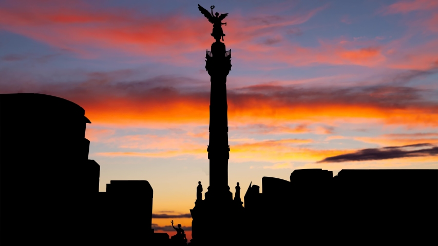 Mexico City: The Angel of Independence, Timelapse at Twilight with Colorfull Clouds and Skyline of City, Mexico