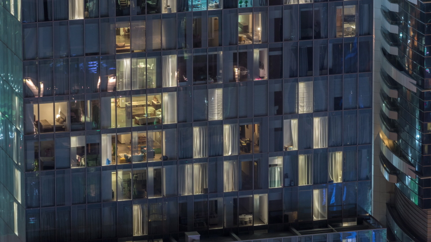 Night view of office and apartment building timelapse. High rise skyscraper with blinking windows with people moving inside. Aerial view from above. Pan up | Shutterstock HD Video #1034786030