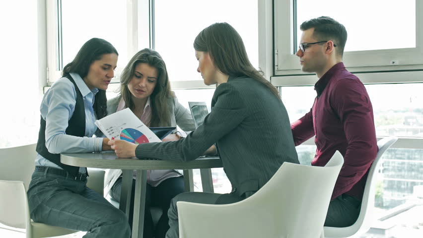 Businesspeople working together on graphs in the office  | Shutterstock HD Video #10348760
