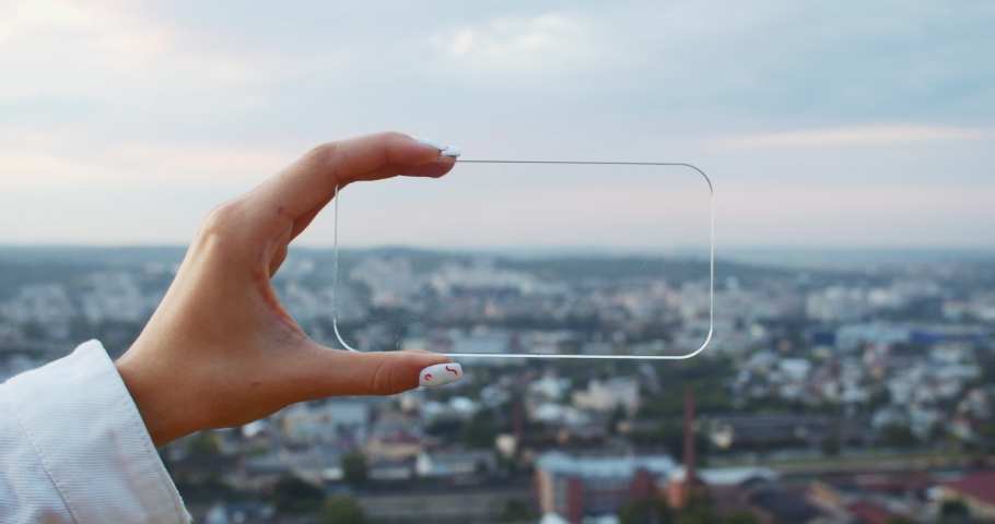 First-person view tourist girl taking pictures on smartphone of the city scenery. Close-up busy person using mobile phone with transparent virtual screen. Vosual effects. | Shutterstock HD Video #1035181790