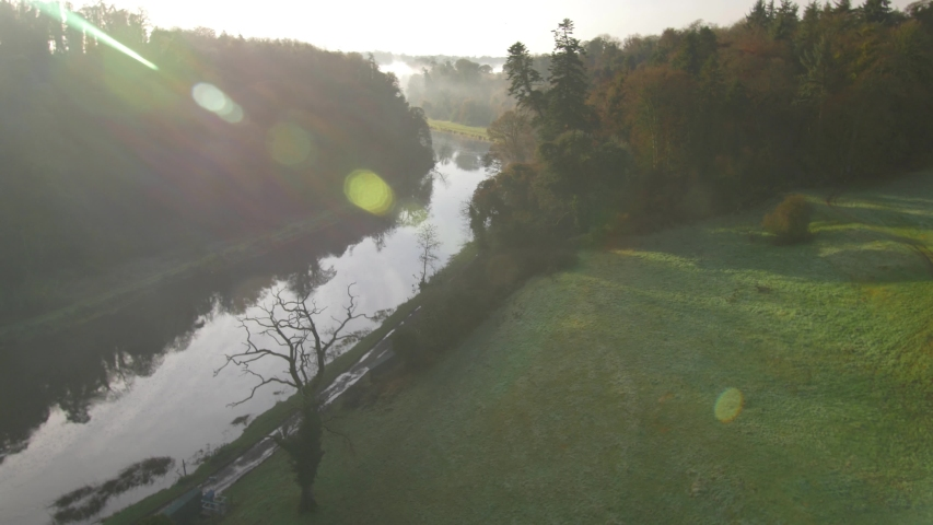 Aerial view. Misty morning Irish river landscape. | Shutterstock HD Video #1035362030