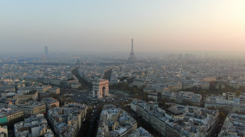 Aerial: Paris City Away From Arc de Triomphe and Traffic Circle, France | Shutterstock HD Video #1035380750