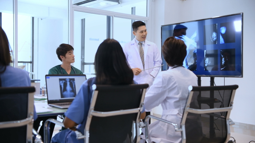 Medical concept. The doctor is presenting the work to the attendees to listen. | Shutterstock HD Video #1035410210