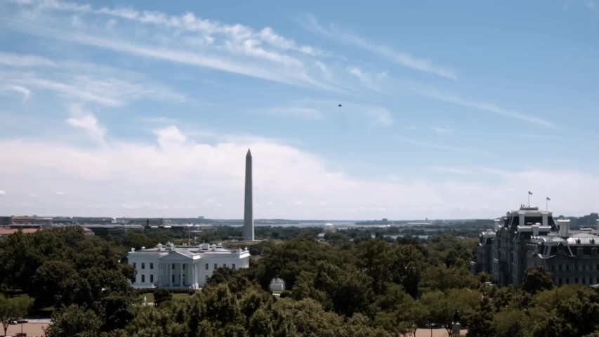 CIRCA 2019 - The Trumps watch an F-35 jet fly over the Washington Monument.