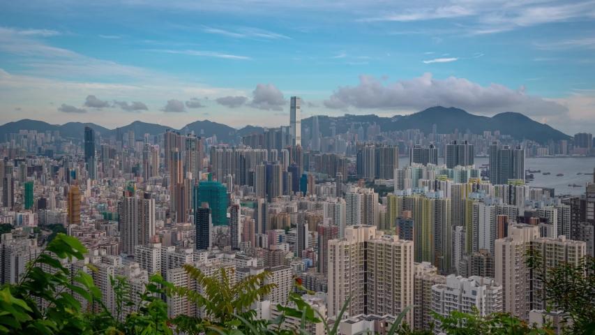 Hong Kong skyscraper building view from harbor at sunset in Hong Kong. | Shutterstock HD Video #1035477080
