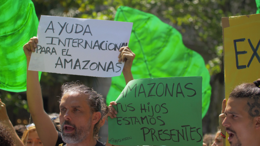 Barcelona, Spain. Circa August 2019: Crowd of People in a demonstration protesting against Brazil Government for the burnning of the Amazon Region #1035732530