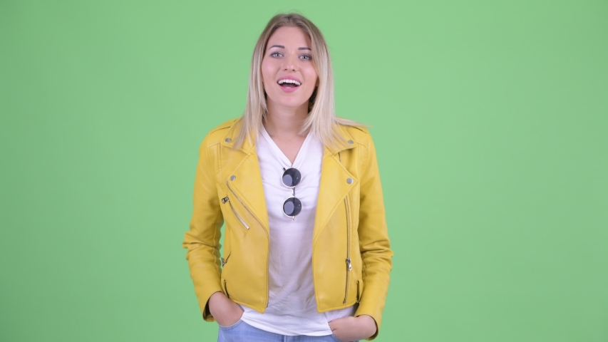 Happy young rebellious blonde woman talking to camera | Shutterstock HD Video #1035920090