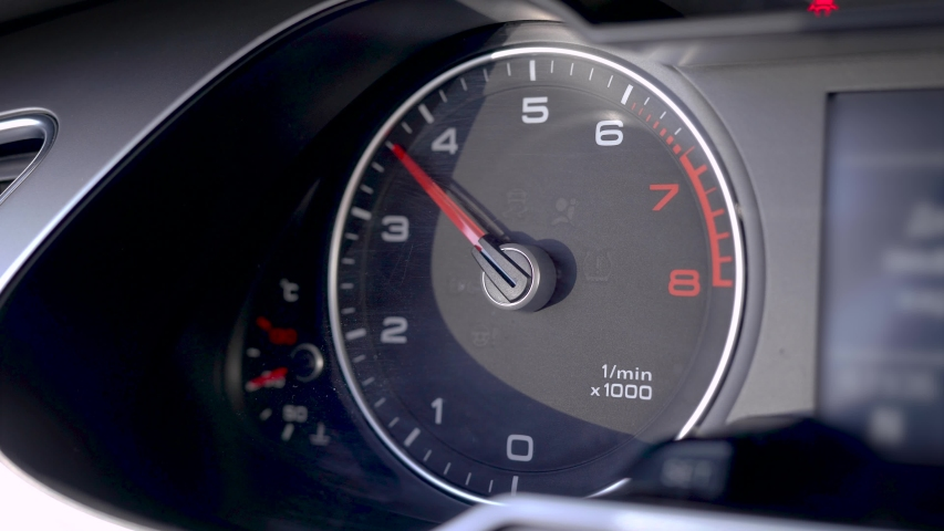 The tachometer shows the engine speed, during the dynamic control of the machine, the speed jumps. | Shutterstock HD Video #1035991190
