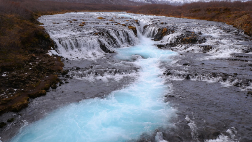 Tilt shot of Bruarfoss waterfall in winter, Reykjavik, Iceland | Shutterstock HD Video #1036058300