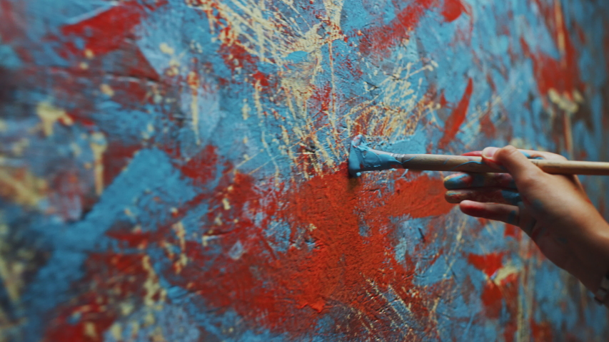 Close-up Shot of Female Artist Hand, Holding Paint Brush and Drawing Painting with Blue Paint. Colorful, Emotional Oil Painting. Contemporary Painter Creating Modern Abstract Piece of Fine Art | Shutterstock HD Video #1036107770