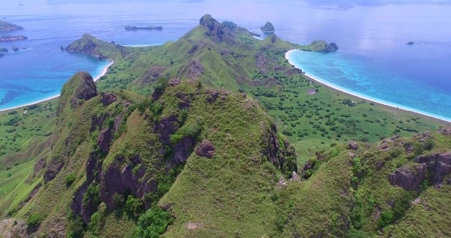 Aerials Flores Komodo National Park includes Island of Padur, Rinca and Pink Beach and Island Villages, Tourist boats and Mountain/Beach Views | Shutterstock HD Video #1036176140