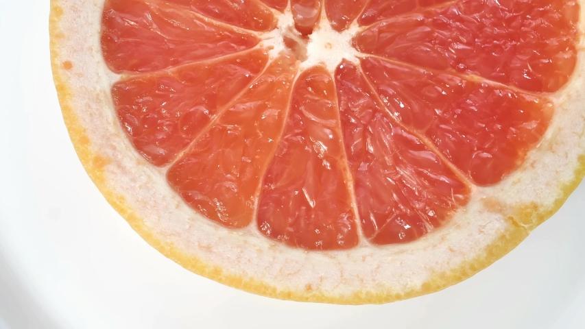 slices of fresh citrus fruit #1036428650