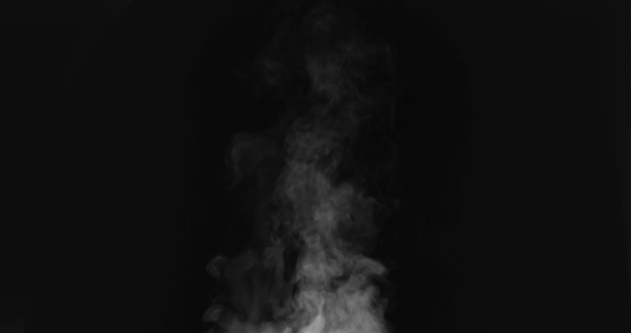 Steam from a Freshly Prepared Dish. White Steam rises from a large pot that is behind the scenes. Black background. Filmed at a speed of 120fps #1036454690